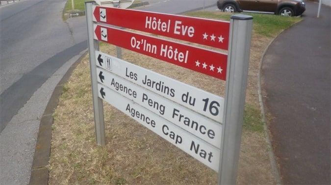 Hotel Eve and Agence Cap Nat signage